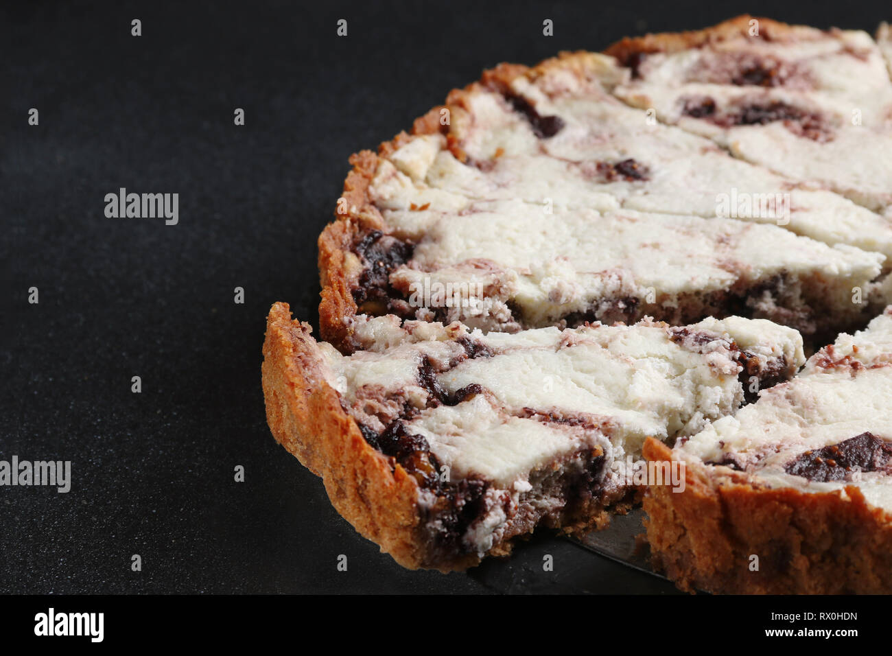 pie with ricotta and cheese close up on dark back Stock Photo
