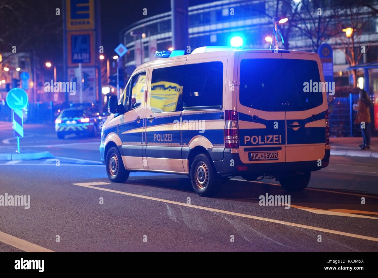 Mainz, Germany - March 01, 2019: A police car with a siren and blue lights is blocking the street after a regional football match on March 01, 2019 in - Stock Image
