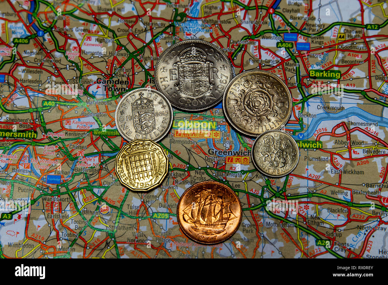 Falls Road, Belfast, UK 7 March 2019. Pre-Decimal Currency on Map of Greater London - Stock Image
