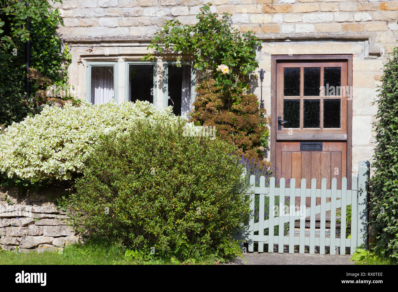 Dark Brown Doors In An Old Traditional English Lime Stone