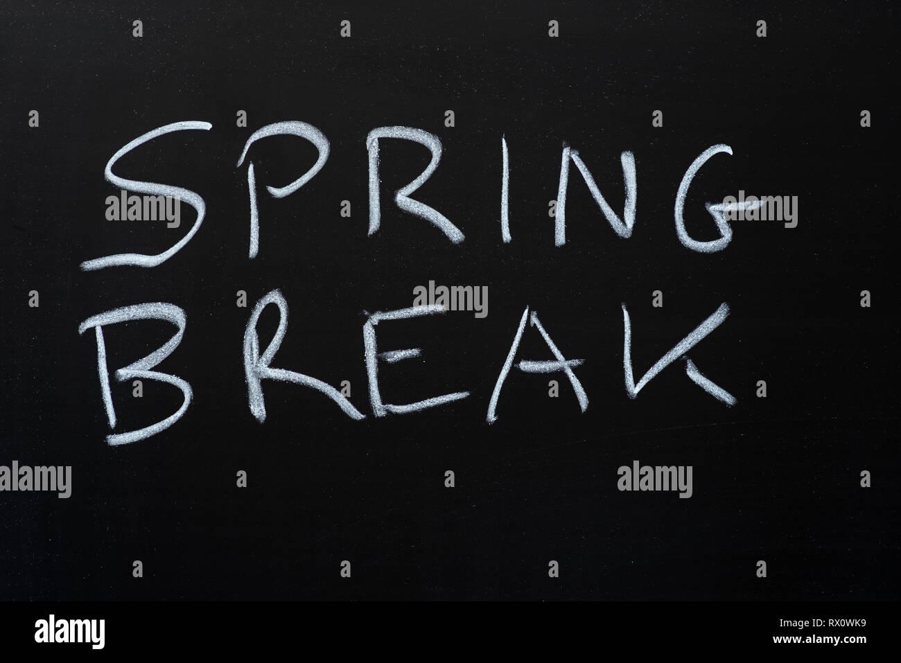 spring break written with chalk on blackboard - Stock Image