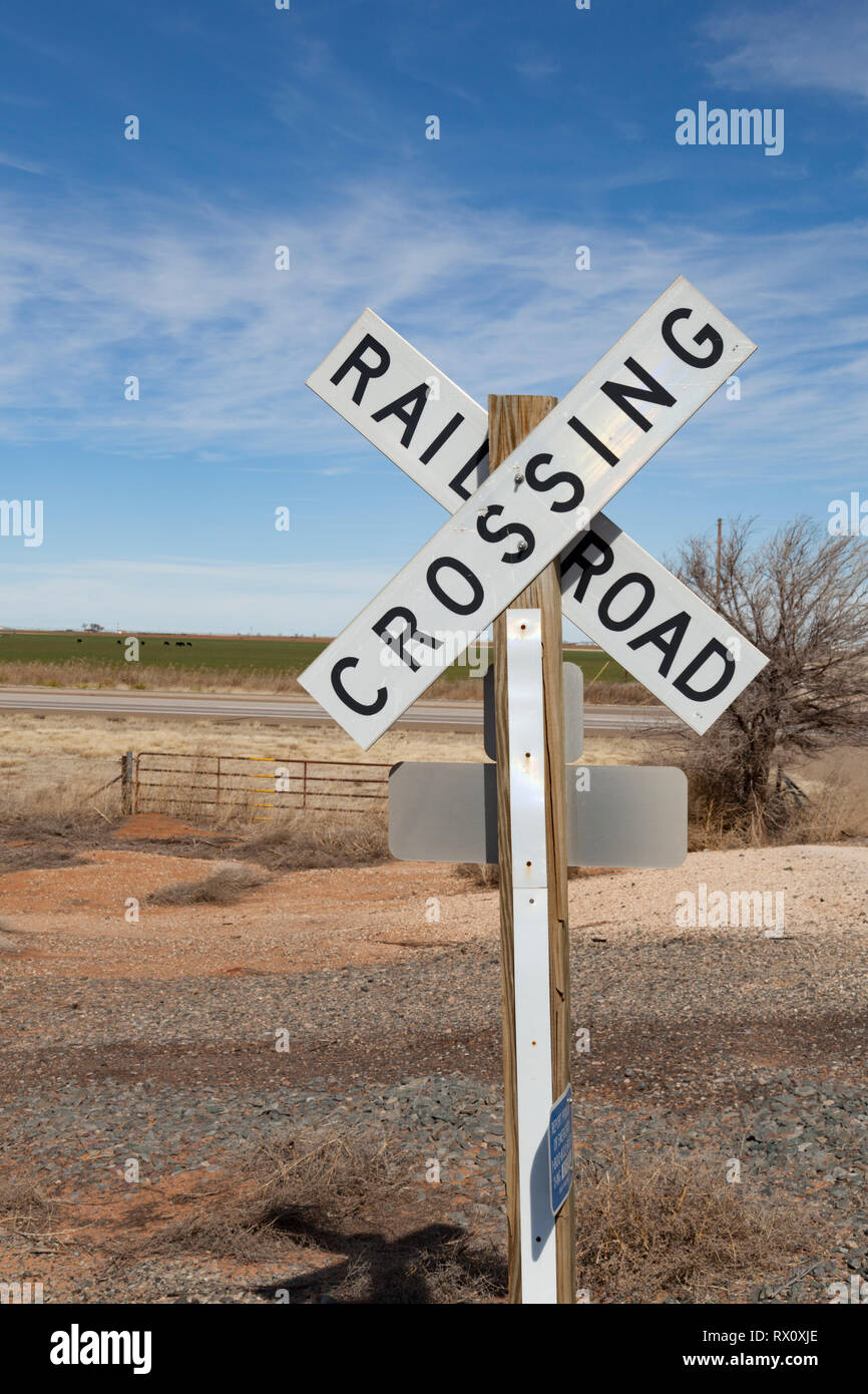 Railroad crossing sign stands in Texas plains - Stock Image