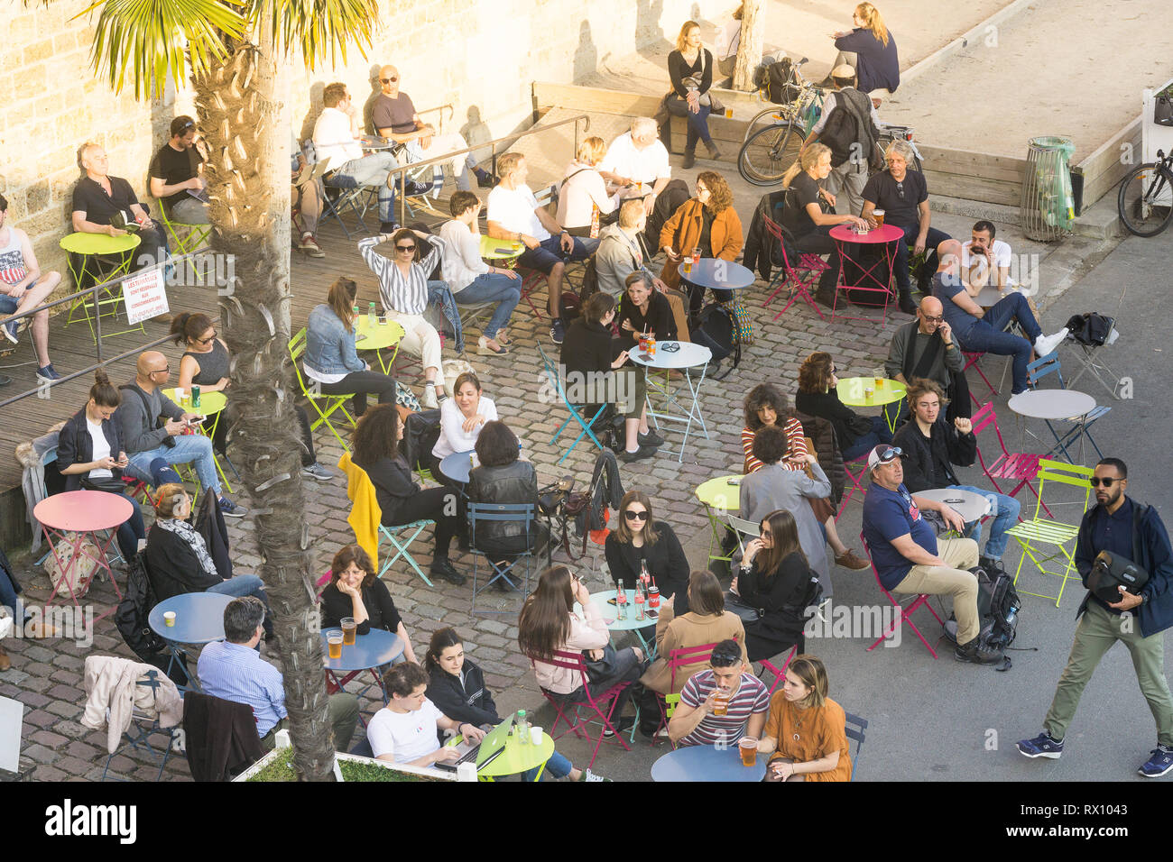 Top view of Parisians having drink on the Seine embankment in Paris, France. - Stock Image