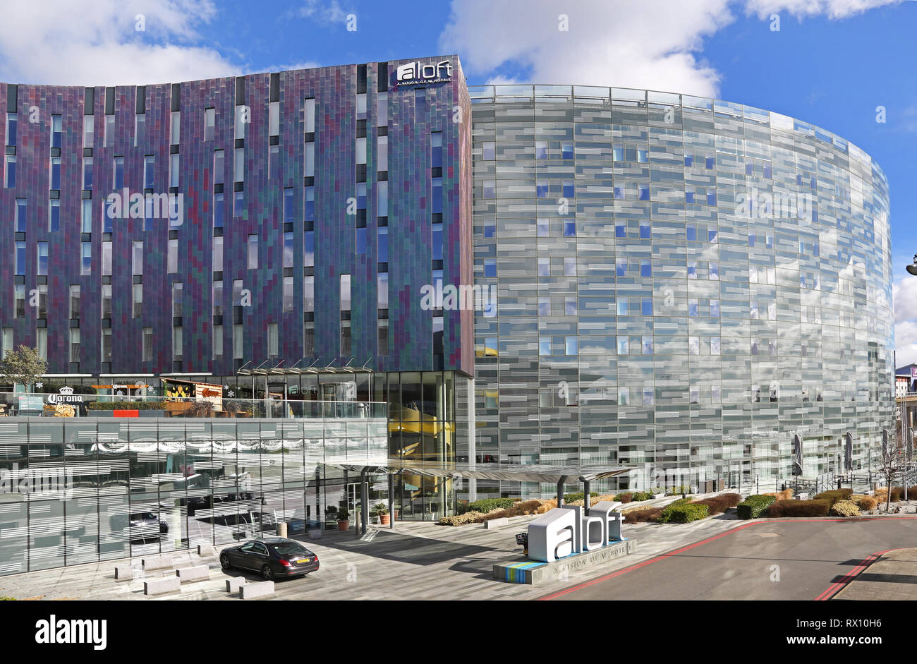 The new 'W' Aloft hotel next to the Excel Exhibition Centre in London's docklands district, east of the City. Shows multi-coloured metallic cladding. - Stock Image