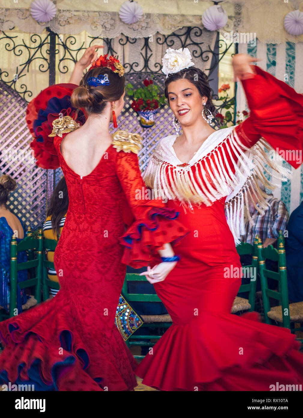 2523f2ddf610 Young and beautiful women wearing flamenco dresses and dancing