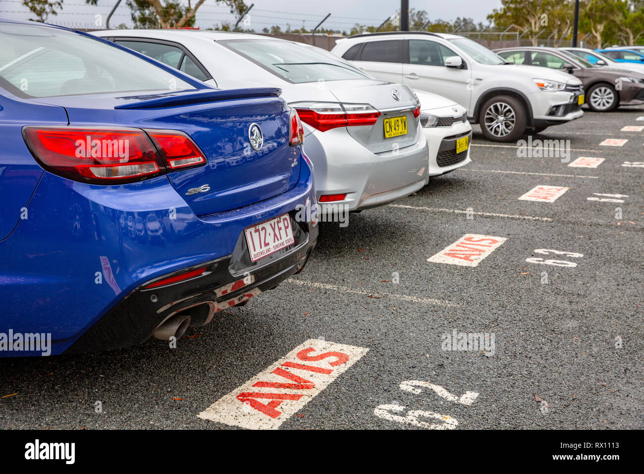 Avis hire cars at Port macquarie airport including a blue Holden commodore sv6, New South Wales,Australia - Stock Image