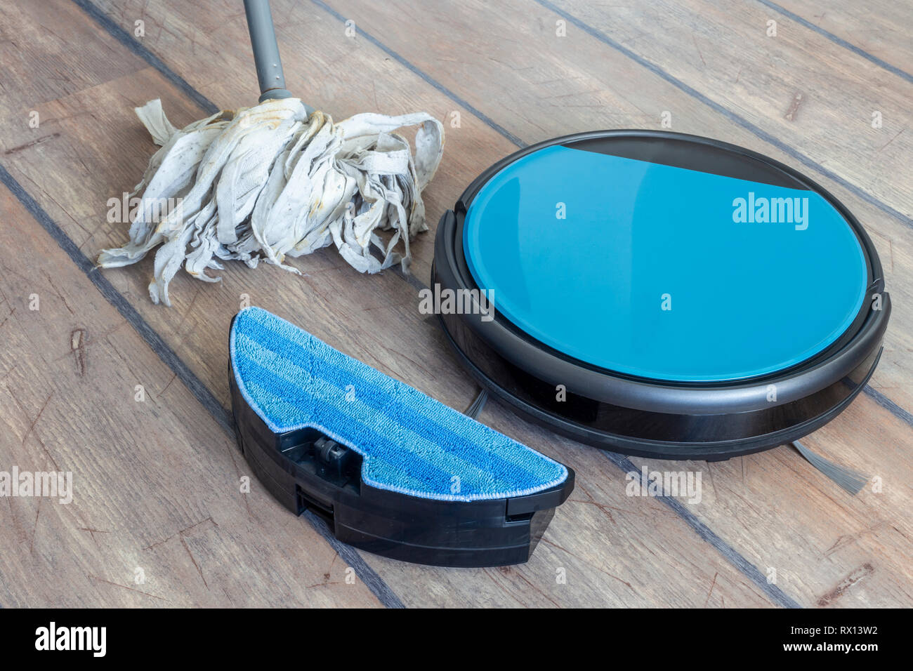 Water tank of a robot vacuum claner. Mop feature with attachment. - Stock Image