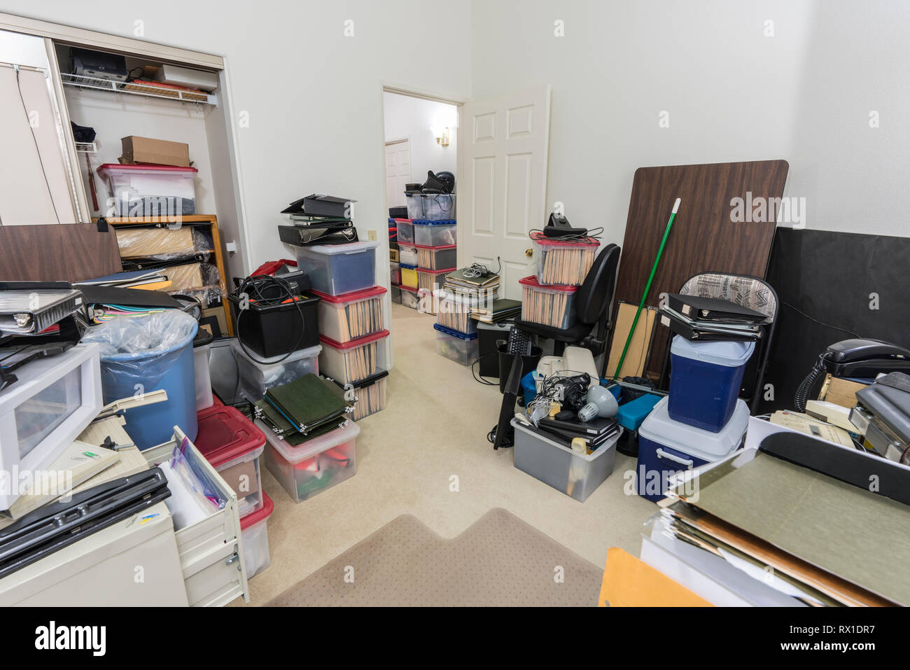 Messy back office with boxes, clutter old equipment and miscellaneous storage. - Stock Image