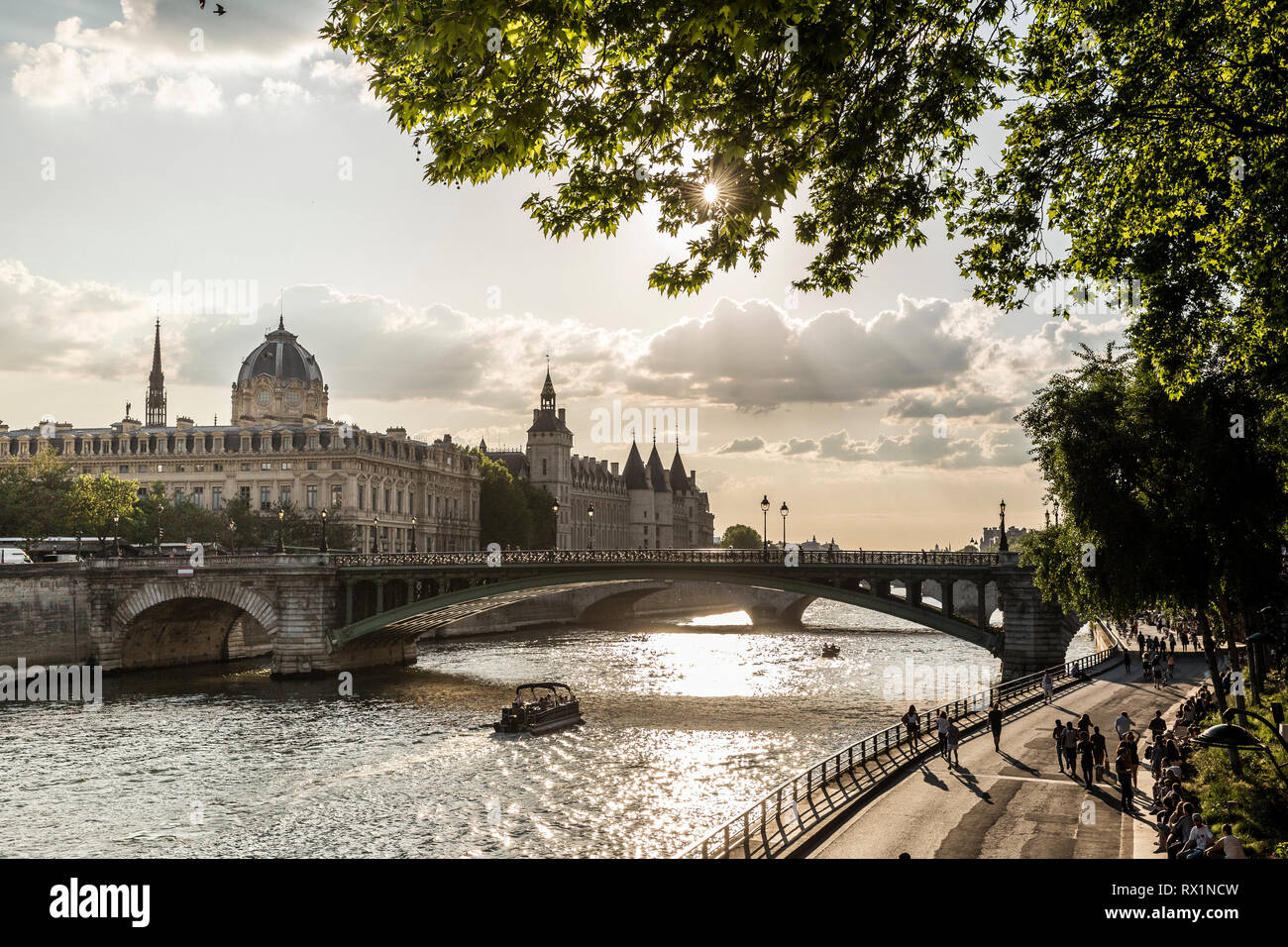 Pont Notre-Dame over Seine River against cloudy sky during sunset - Stock Image