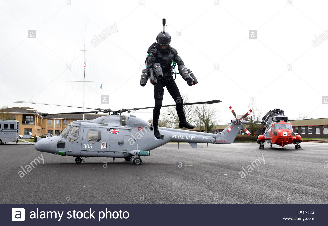 Richard Browning the founder of Gravity Industries demonstrates his jet-powered flying suit at HMS Sultan in Gosport Hampshire - Stock Image