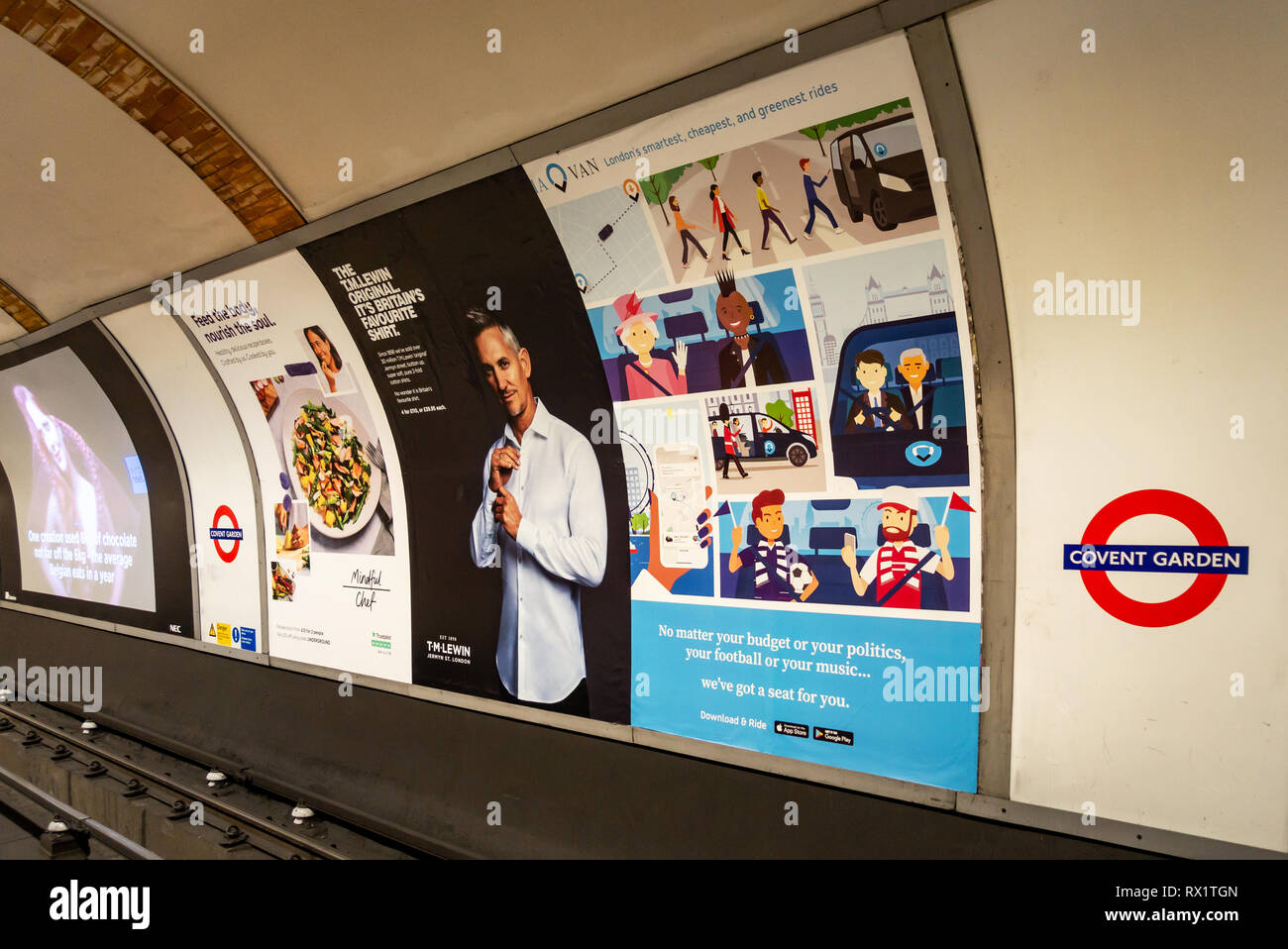 Billboard Advertising posters on the Underground Tube at Covent Garden, London - Stock Image