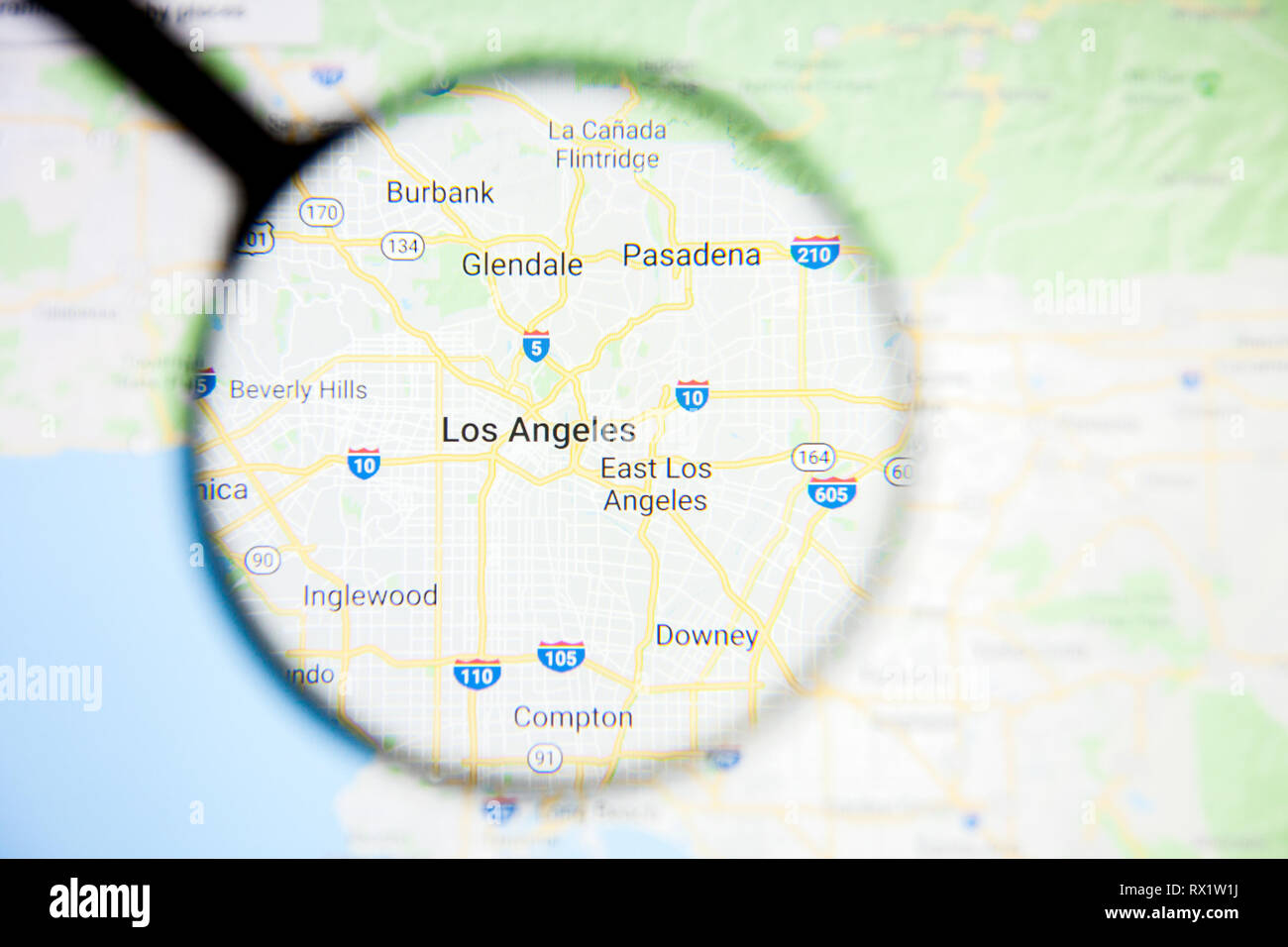 Los Angeles city visualization illustrative concept on display screen through magnifying glass - Stock Image
