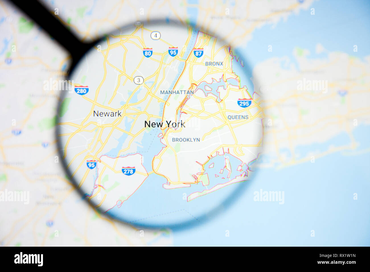 New York city visualization illustrative concept on display screen through magnifying glass - Stock Image