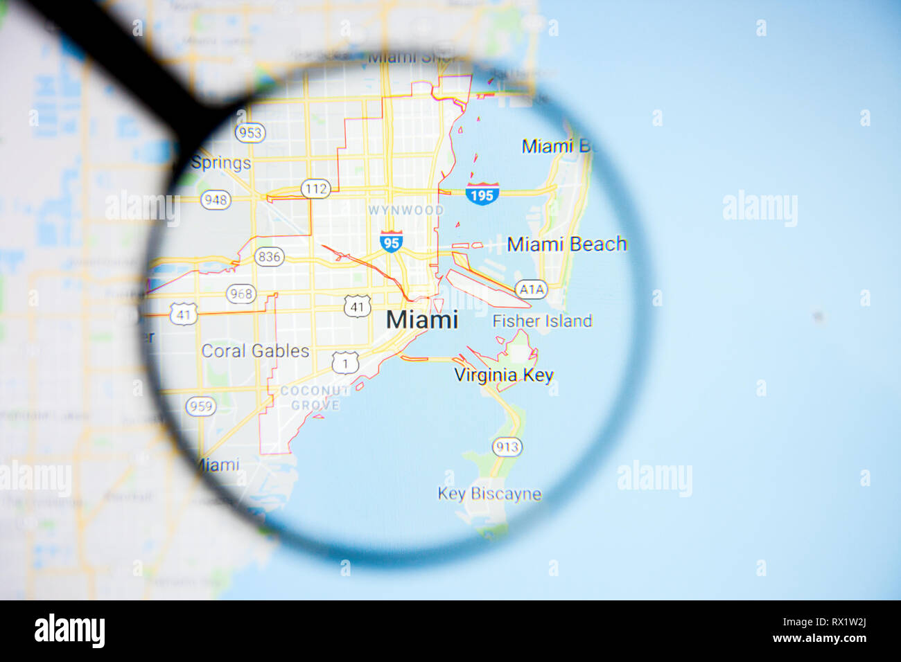 Miami city visualization illustrative concept on display screen through magnifying glass - Stock Image