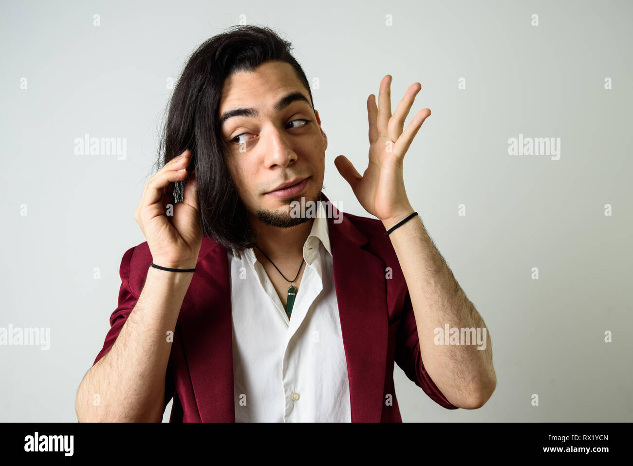 Young man with gesture of paying attention, isolated on white - Stock Image