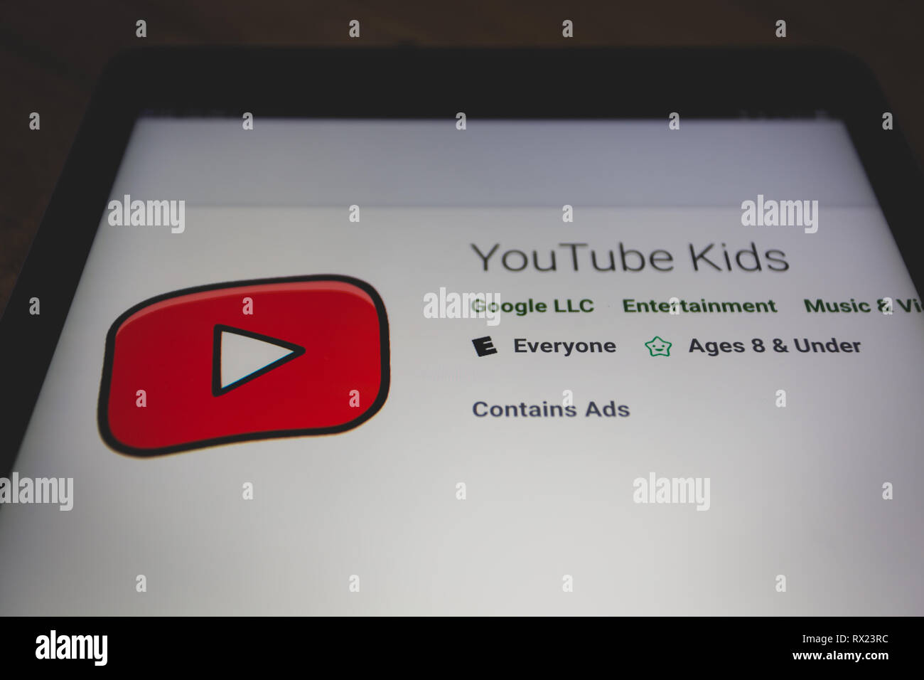 YouTube Kids app logo on Google Play store is shown on tablet screen - Stock Image