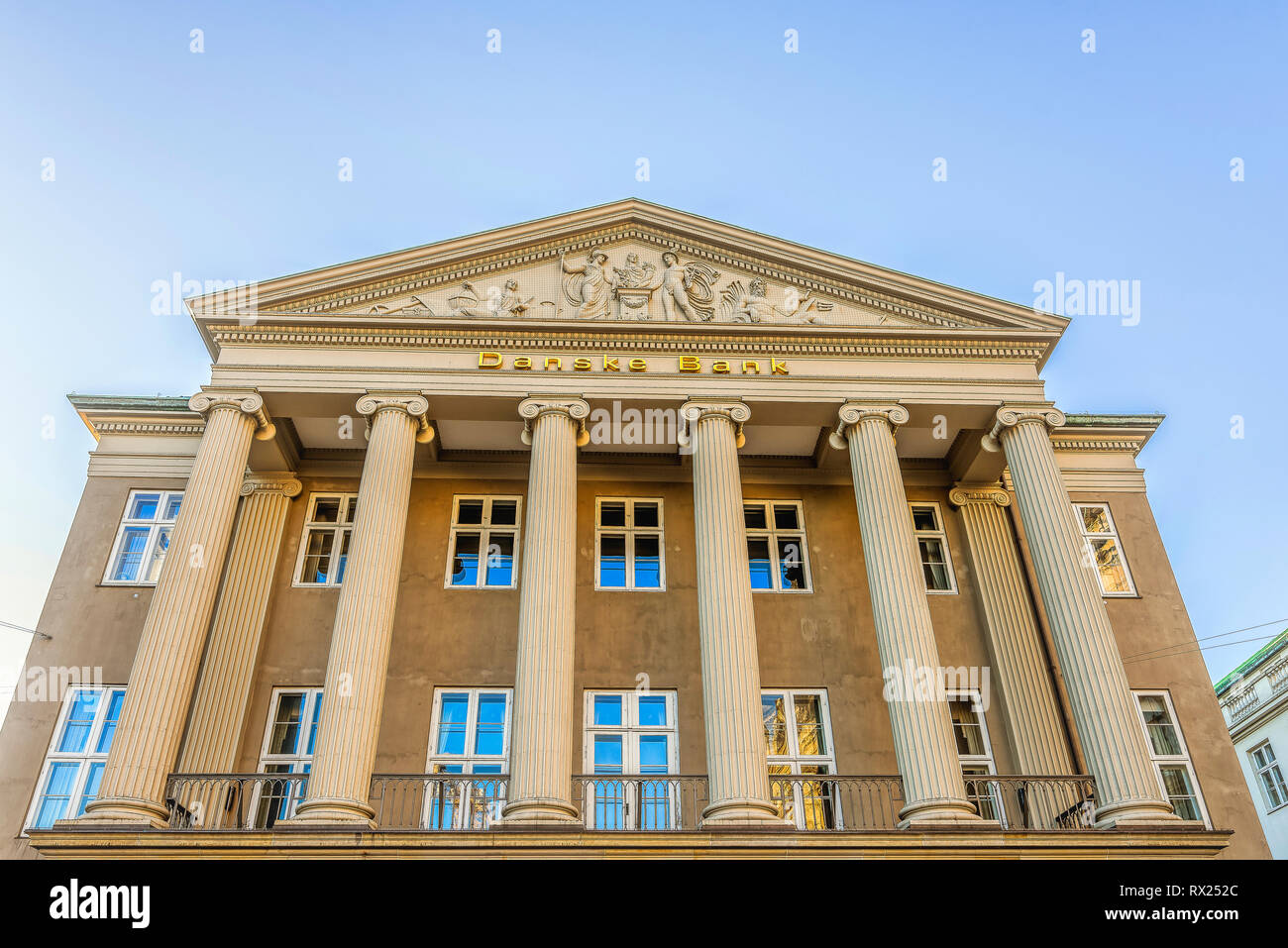 The facade of the money laundering Danish Bank with ionic columns and a sclprured pediment, Copenhagen, February 16, 2019 - Stock Image