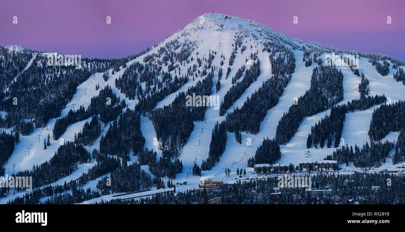 Night Skiing runs light up on Mount Washington ski resort as dusk settles on the popular Vancouver Island ski resort., The Comox Valley, Vancouver Isl - Stock Image