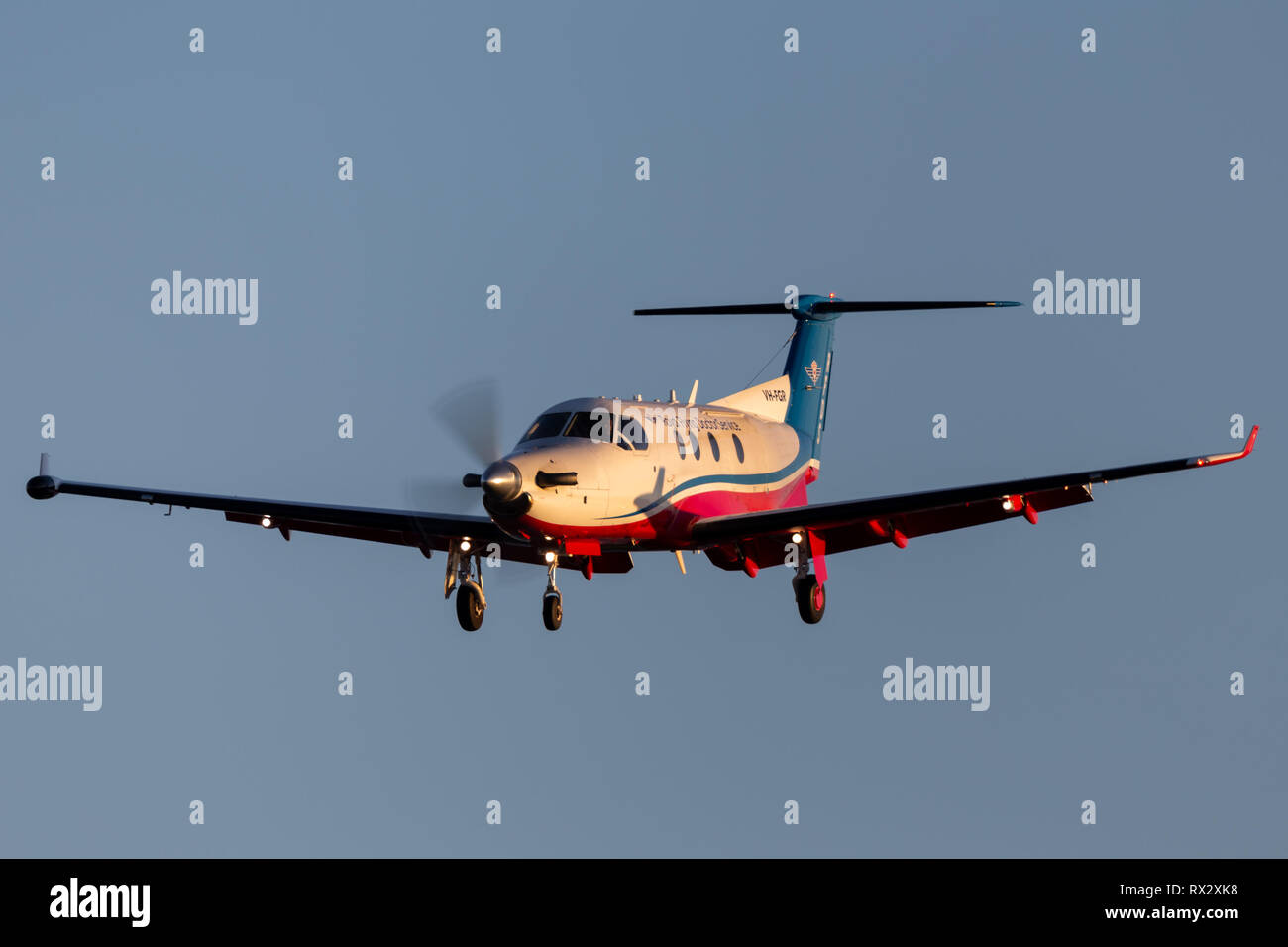 Royal Flying Doctors Service of Australia Pilatus PC-12 single engine air ambulance aircraft on approach to land at Adelaide Airport. - Stock Image
