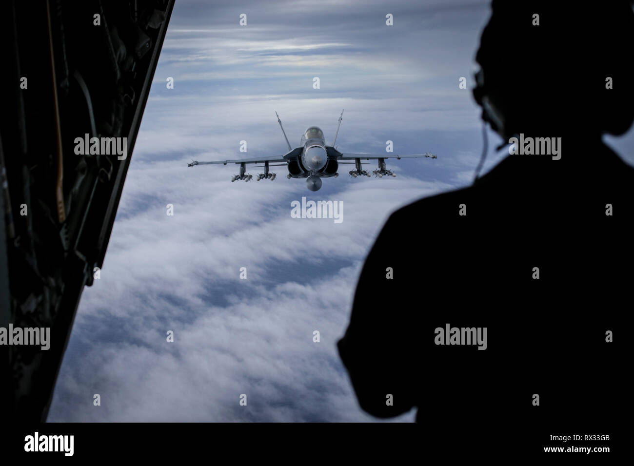 An F/A-18 Hornet with Marine Fighter Attack Squadron (VMFA) 323, MAG-11, 3rd Marine Aircraft Wing (MAW), carrying ten AIM-120 and two AIM-9X Air-to-Air missiles, prepares to refuel prior to a training mission over the W-291 training area in southern California, March 6.  MAG-11 supports and integrates aviation combat power and capabilities while enhancing 3rd MAW's ability generate lethality for the supported Marine Air-Ground Task Force (MAGTF). (U.S Marine Corps photo by Sgt. David Bickel) Stock Photo