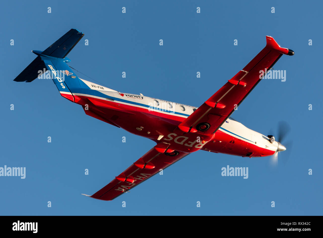 Royal Flying Doctors Service of Australia Pilatus PC-12 single engine air ambulance aircraft taking off from Ad - Stock Image