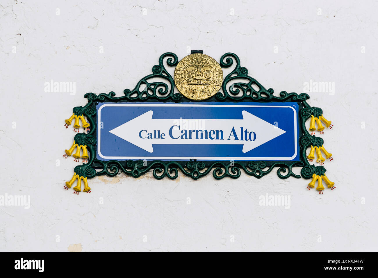 Traditional street sign decorated with Inca motifs and the national flower of Peru called Cantuta (Cusco, Peru) Stock Photo