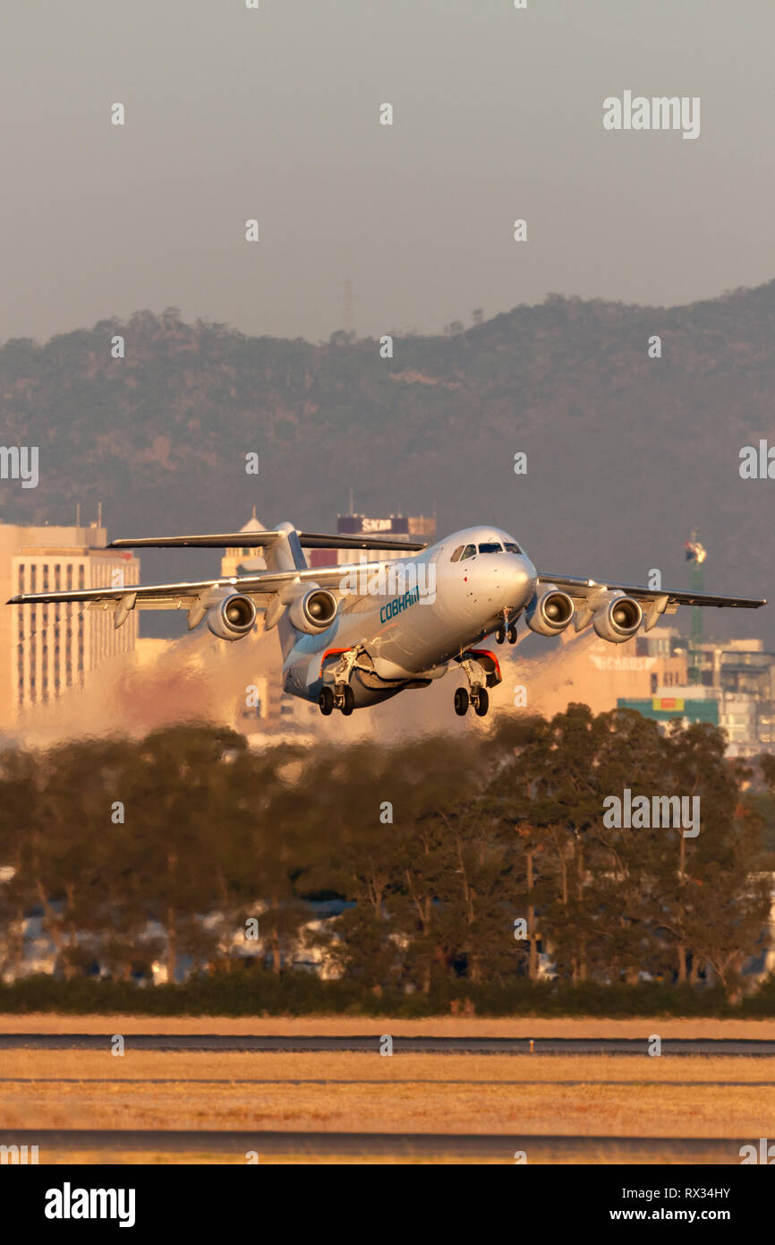 Cobham Aviation British Aerospace 146-300 aircraft VH-NJZ taking off from Adelaide Airport. Stock Photo