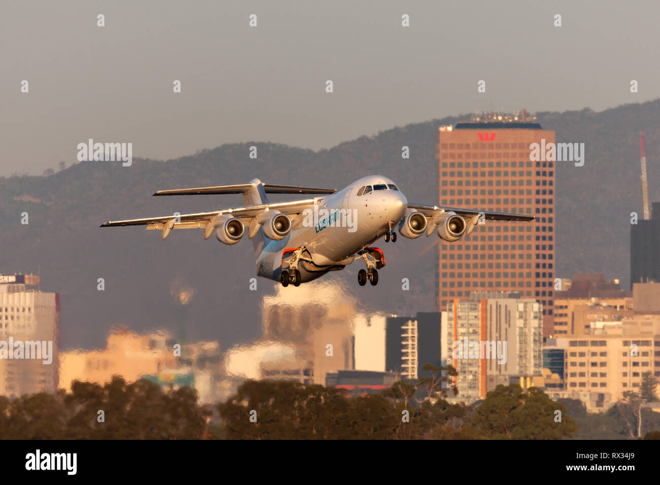 Cobham Aviation British Aerospace 146-300 aircraft VH-NJZ taking off from Adelaide Airport. - Stock Image