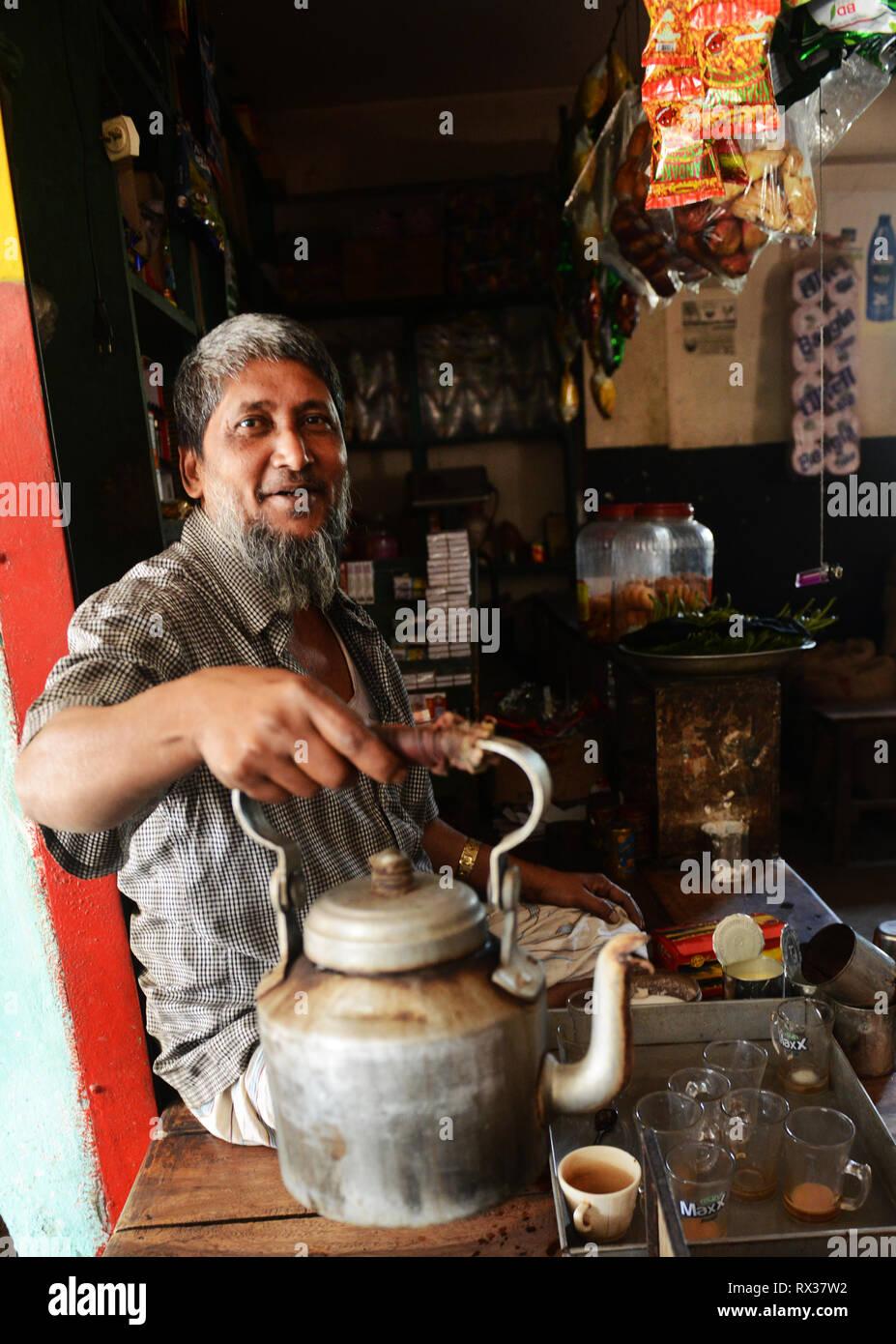 A Bangladeshi man preparing Bangladeshi tea. - Stock Image
