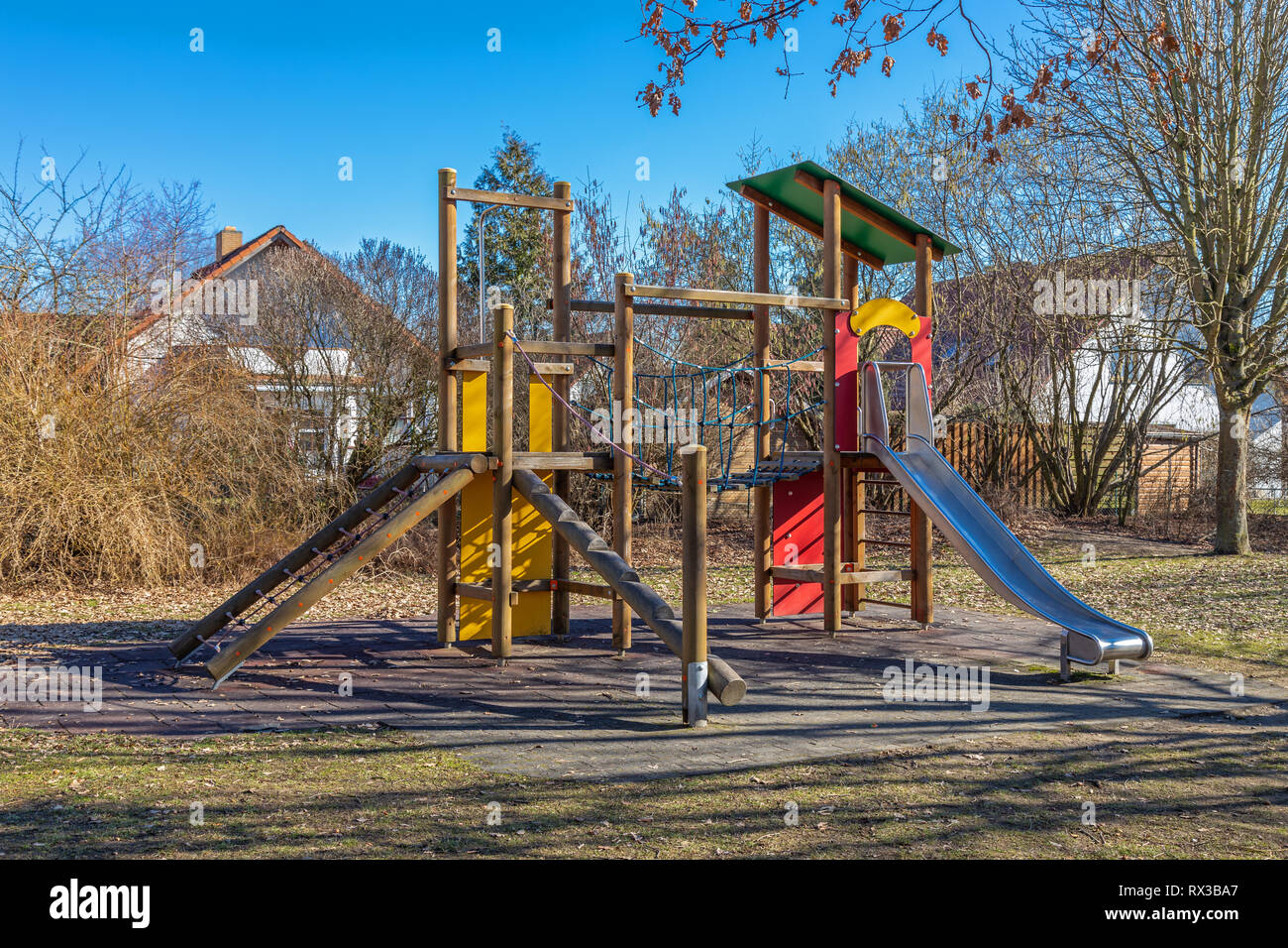 Jungle gym on a deserted playground in late autumn - Stock Image