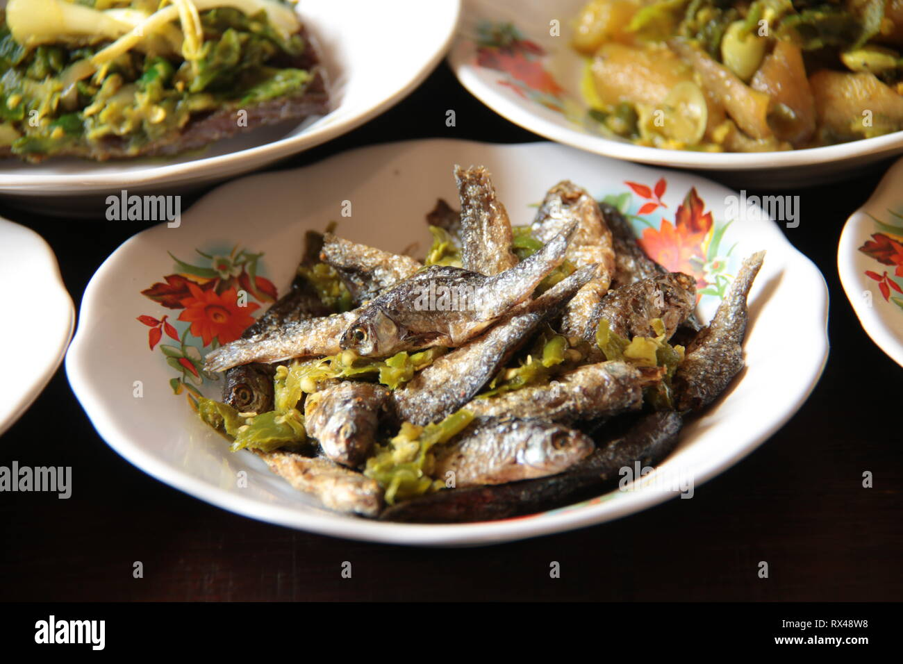 Ikan Bilis. Crispy anchovies with green chili pepper from Padang, West Sumatra - Stock Image