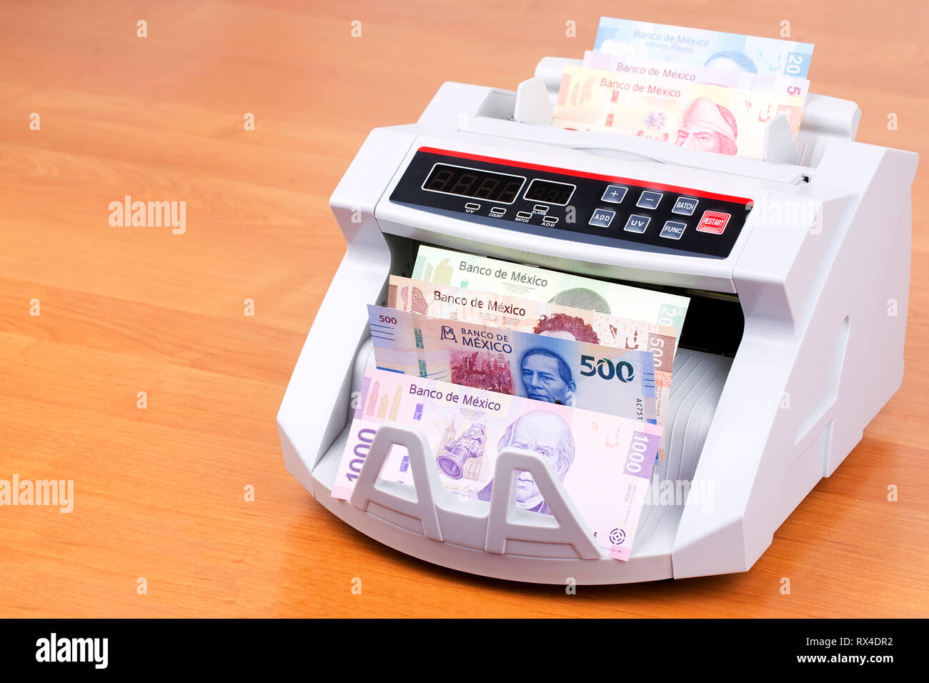 Mexican Peso in a counting machine Stock Photo: 239814486