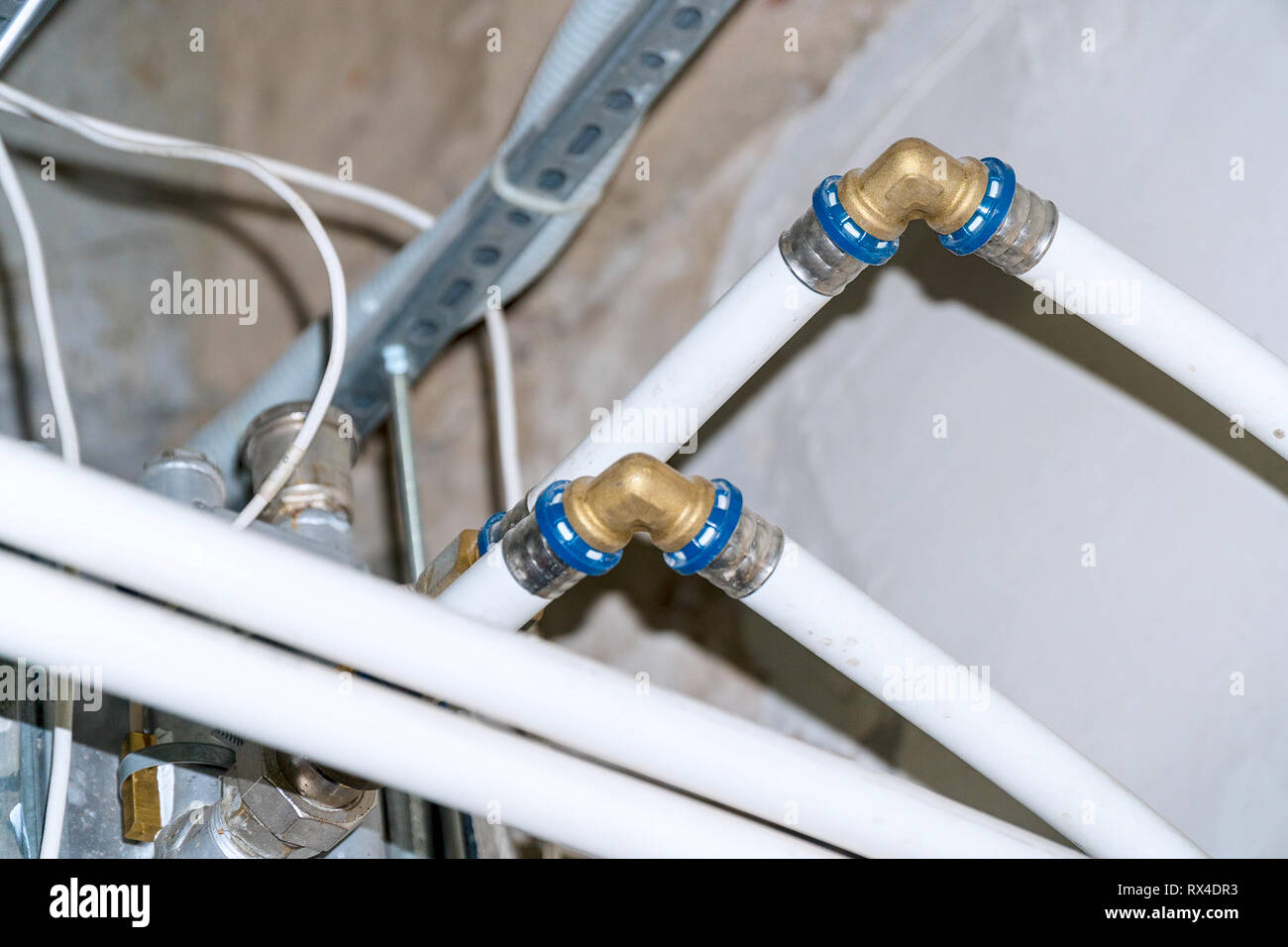 Connection of plastic pipes through fittings - Stock Image