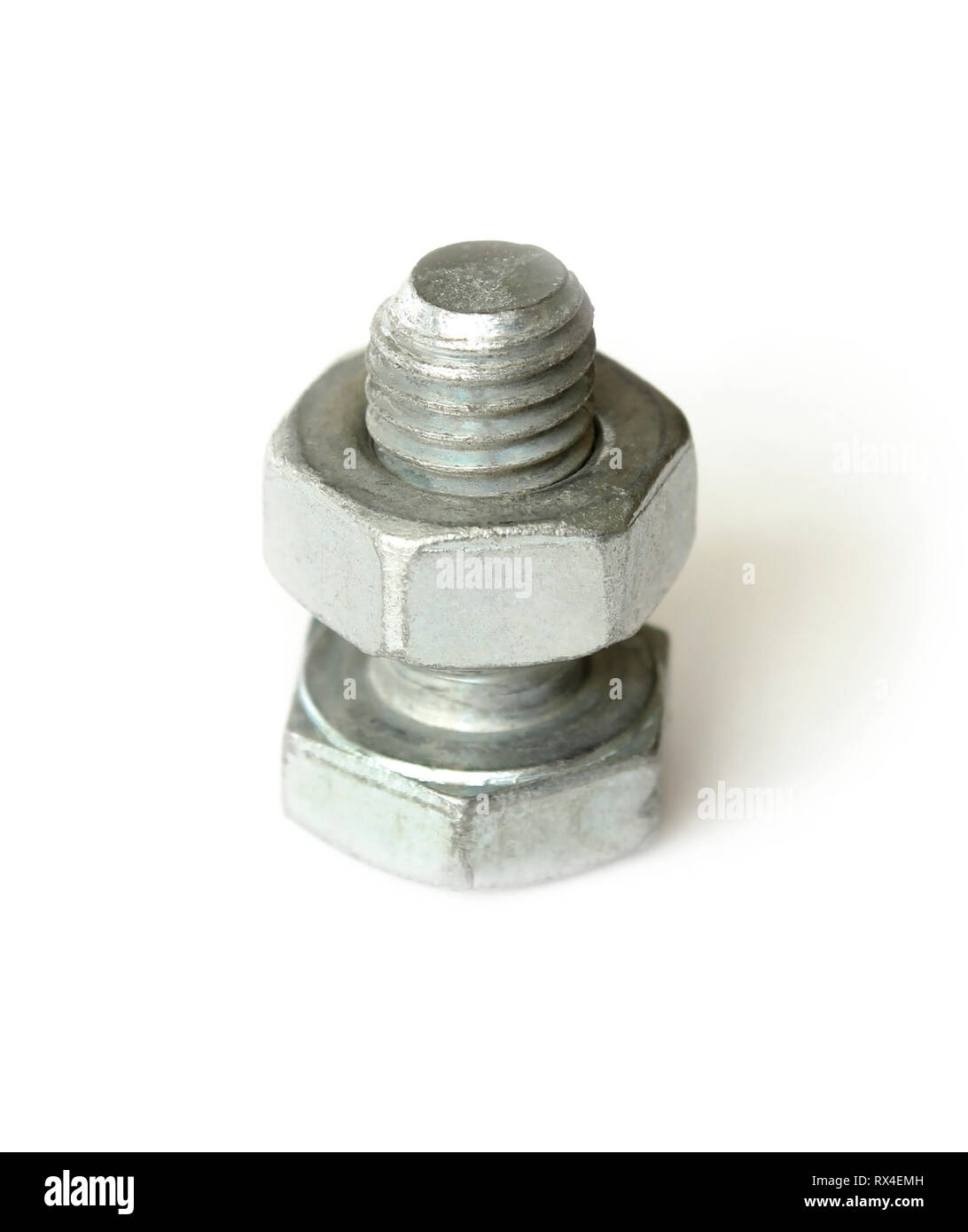 Screw bolt with nut on it isolated on a white background - Stock Image