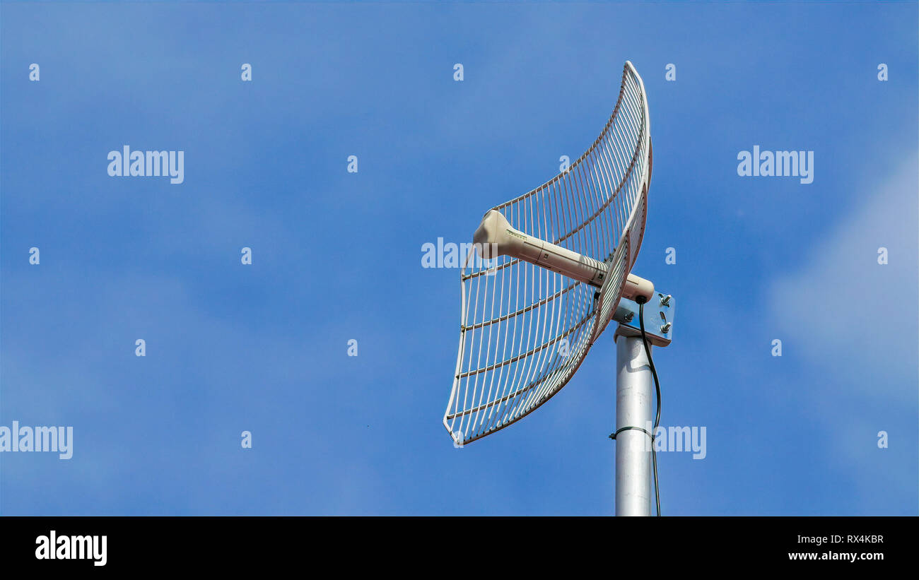 An antenna on top of the pole. This antenna is for communication purposes - Stock Image