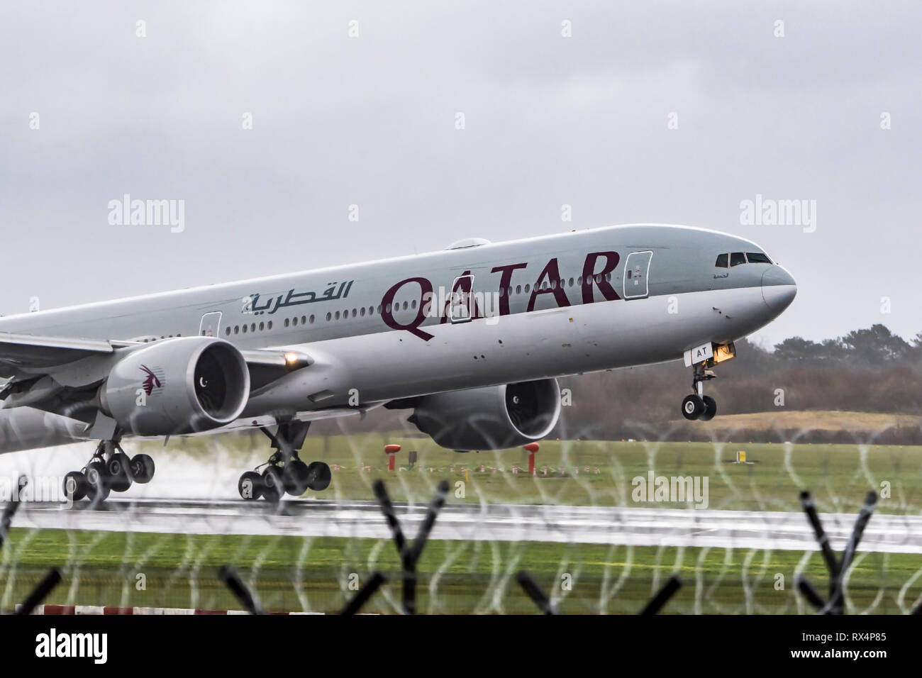 Qatar Airways Boeing 777 takes off. - Stock Image