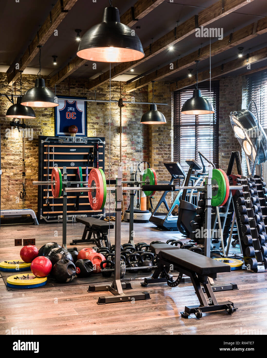Exercise equipment in rustic gym - Stock Image