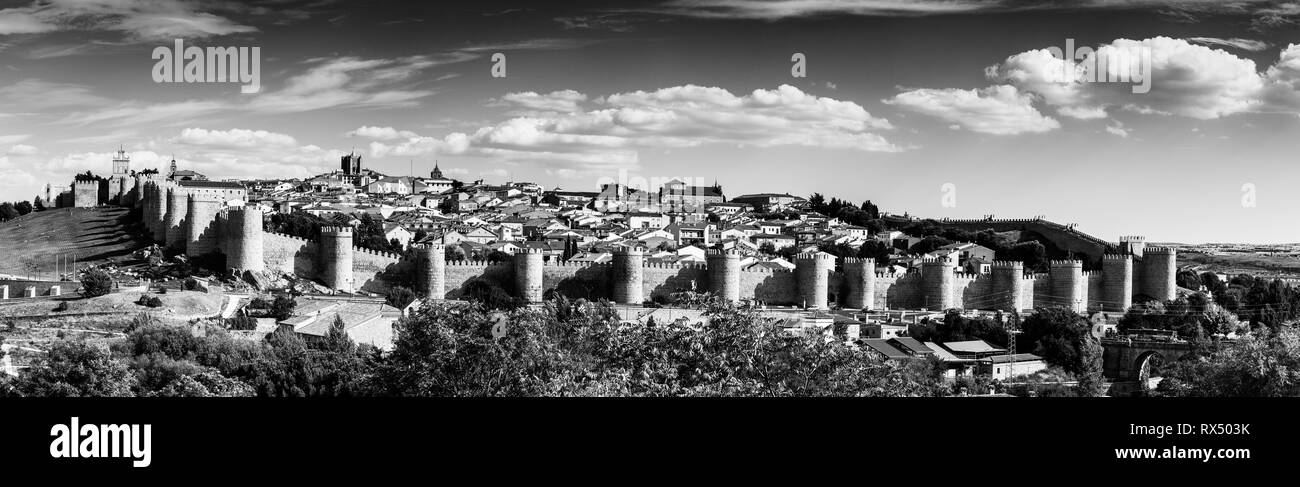 Panoramic view of the historic city of Avila from the Mirador of Cuatro Postes, Spain, with its famous medieval town walls. UNESCO World Heritage. Cal - Stock Image
