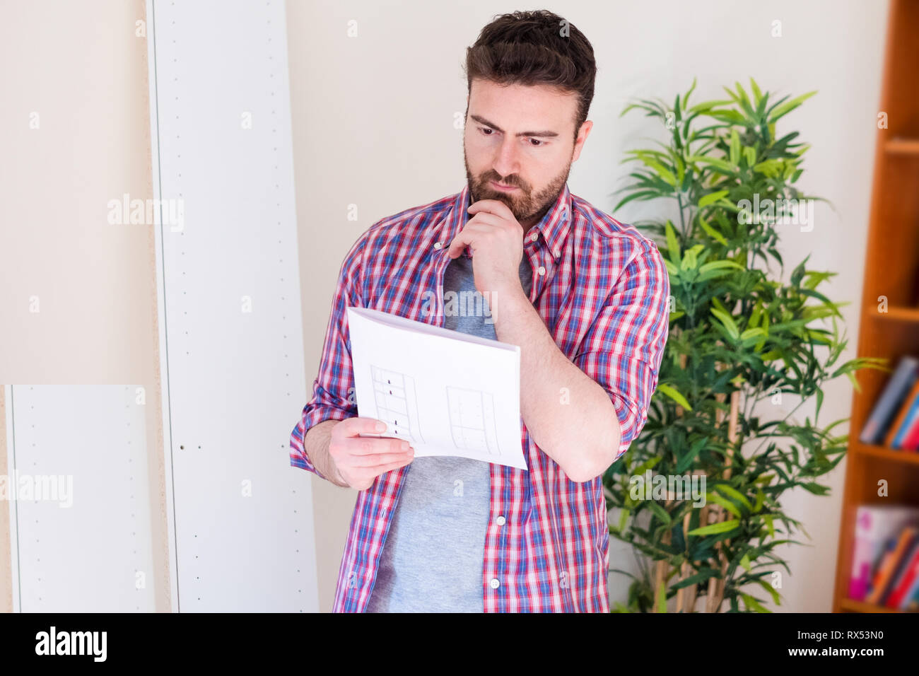 Man portrait and do it yourself furniture assembly - Stock Image