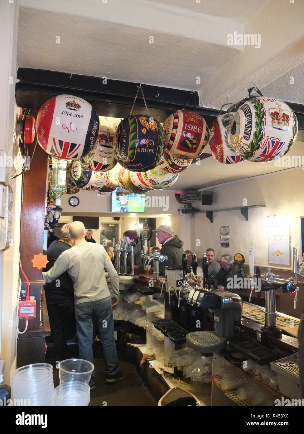 Painted balls from previous years' play in Ashbourne Shrovetide Football game hang in the bar at The Wheel Inn, Compton, Ashbourne, prior to 2019 game Stock Photo