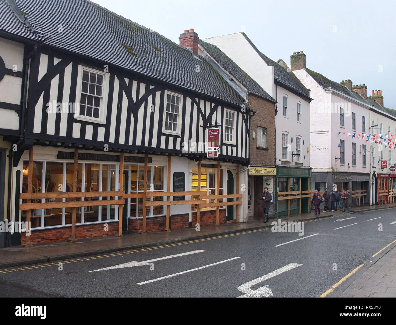 Ashbourne Shrovetide Football 2019. Shops in the historic town including the Tudor Ashbourne Gingerbread Shop are boarded up prior to the match. Stock Photo