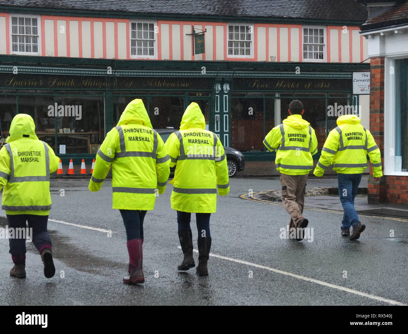 Ashbourne Shrovetide Football 2019. Game marshals in high vis jackets patrol the streets of the historic town prior to the Ash Wednesday match. Stock Photo