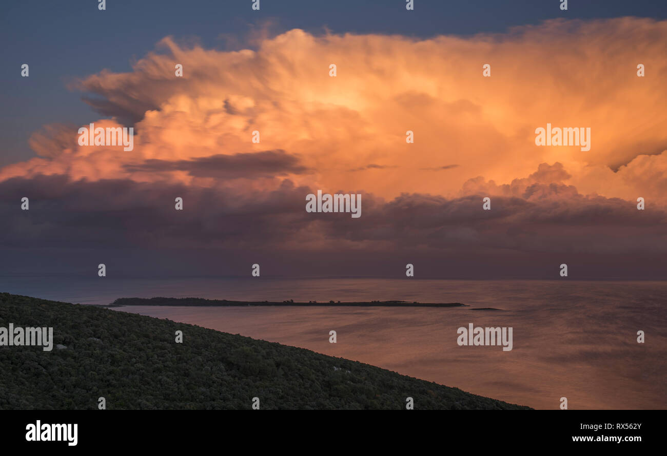 The last rays of the sun lit up the eruption of cumulonimbus cloud above Velebit,Mali Losinj(Croatia) - Stock Image