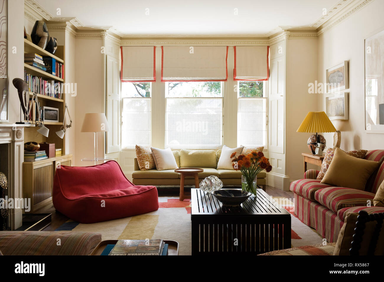 Country style living room with bay window Stock Photo ...