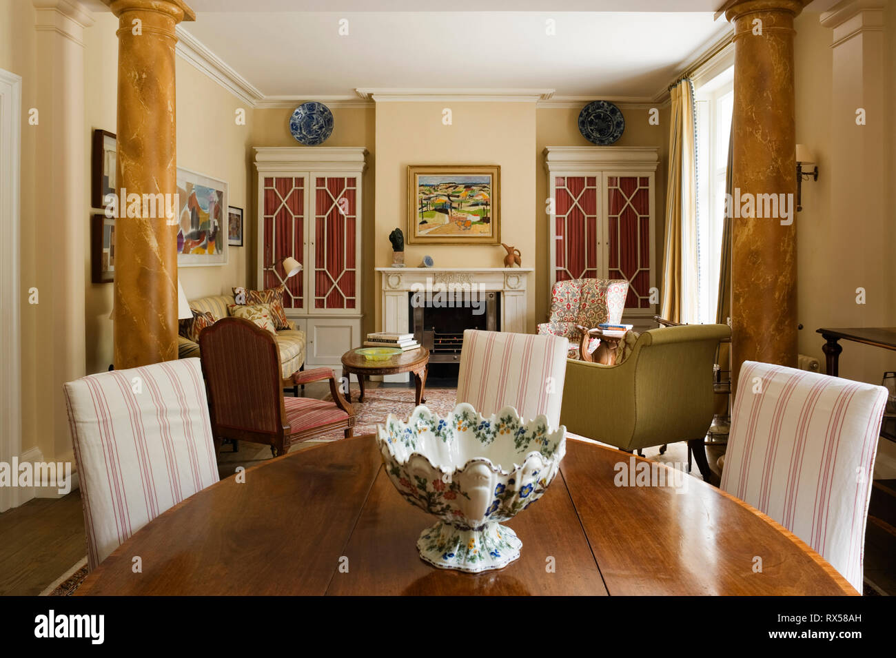 Country style dining room with striped chairs Stock Photo ...
