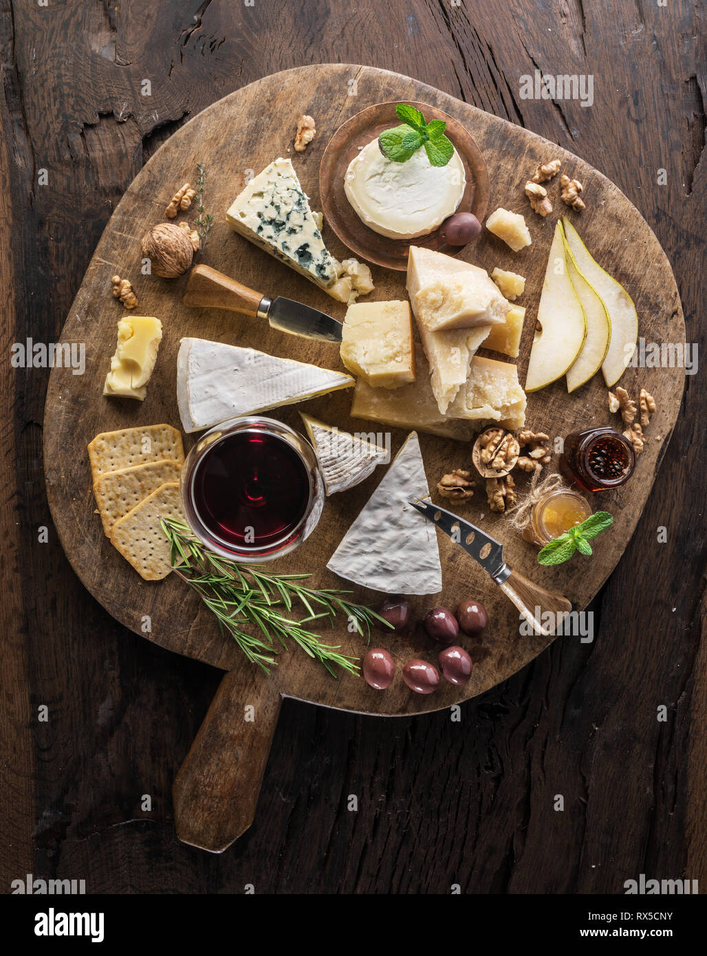 Cheese Platter With Organic Cheeses Fruits Nuts And Wine On Wooden Background Top View Tasty Cheese Starter Stock Photo Alamy