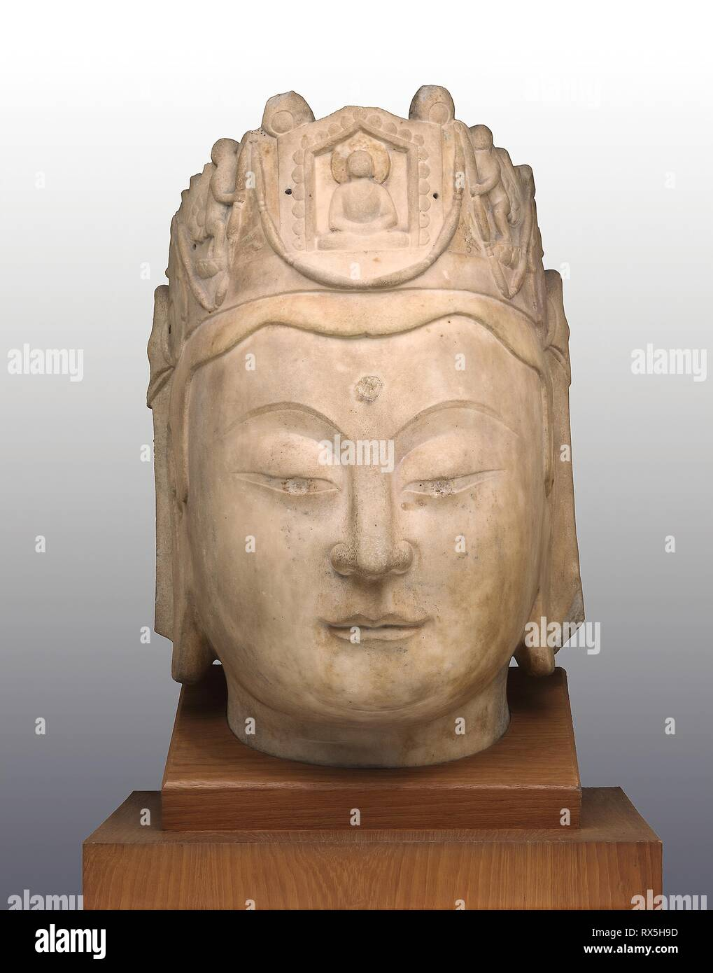 Head of Guanyin. China. Date: 575 AD-600 AD. Dimensions: 68.6 × 43.2 × 45.7 cm (27 1/16 × 17 1/16 × 18 in.). Marble with traces of metal fittings at crown. Origin: China. Museum: The Chicago Art Institute. Stock Photo