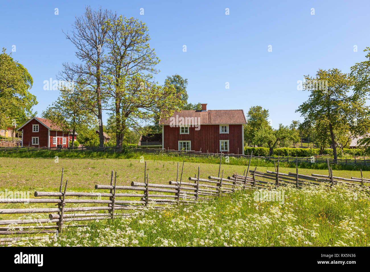 Farm houses in a old rural landscape view - Stock Image