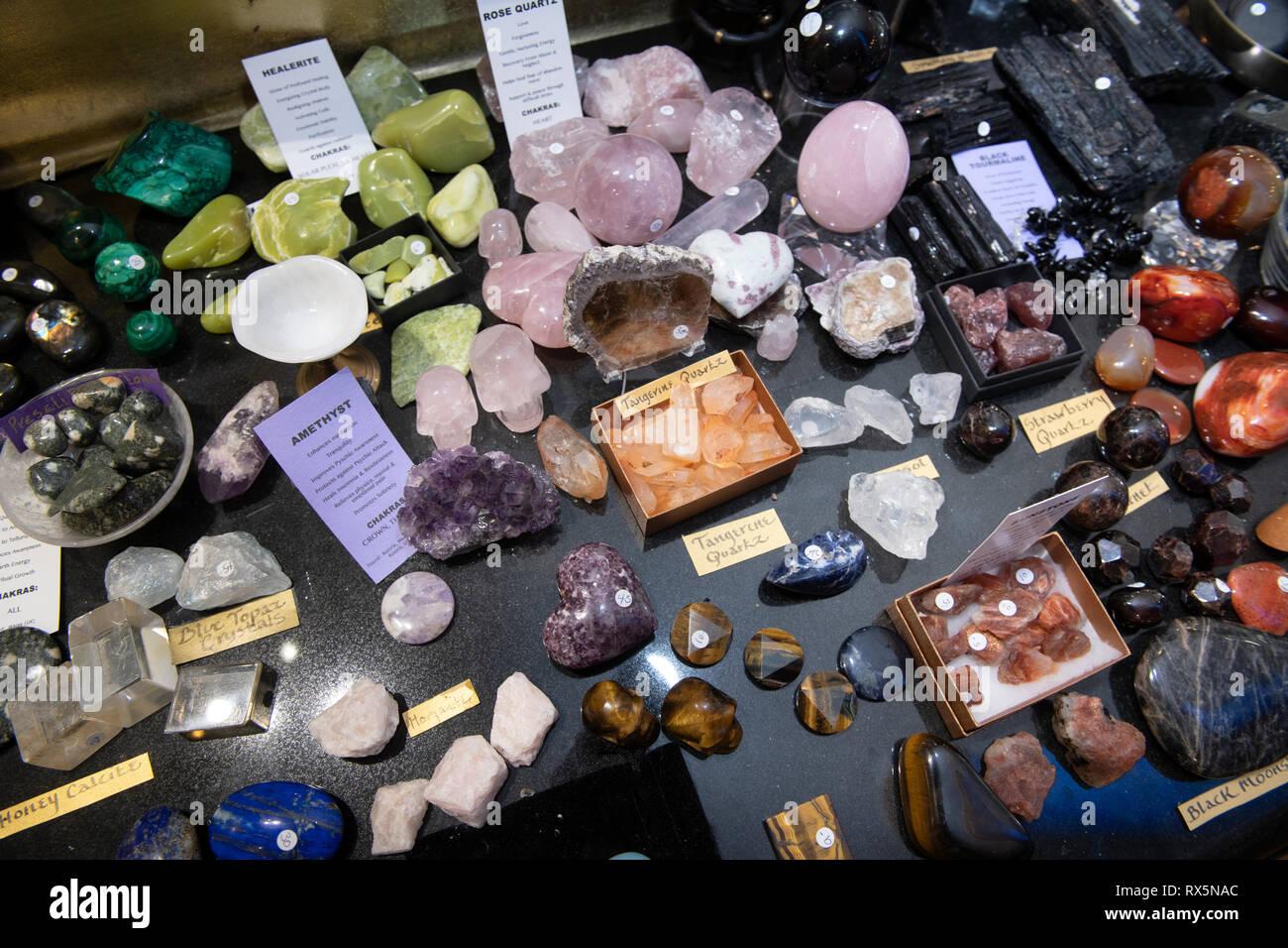 Tangerine Quartz amongst other crystals on sale in Glastonbury, Somerset UK - Stock Image