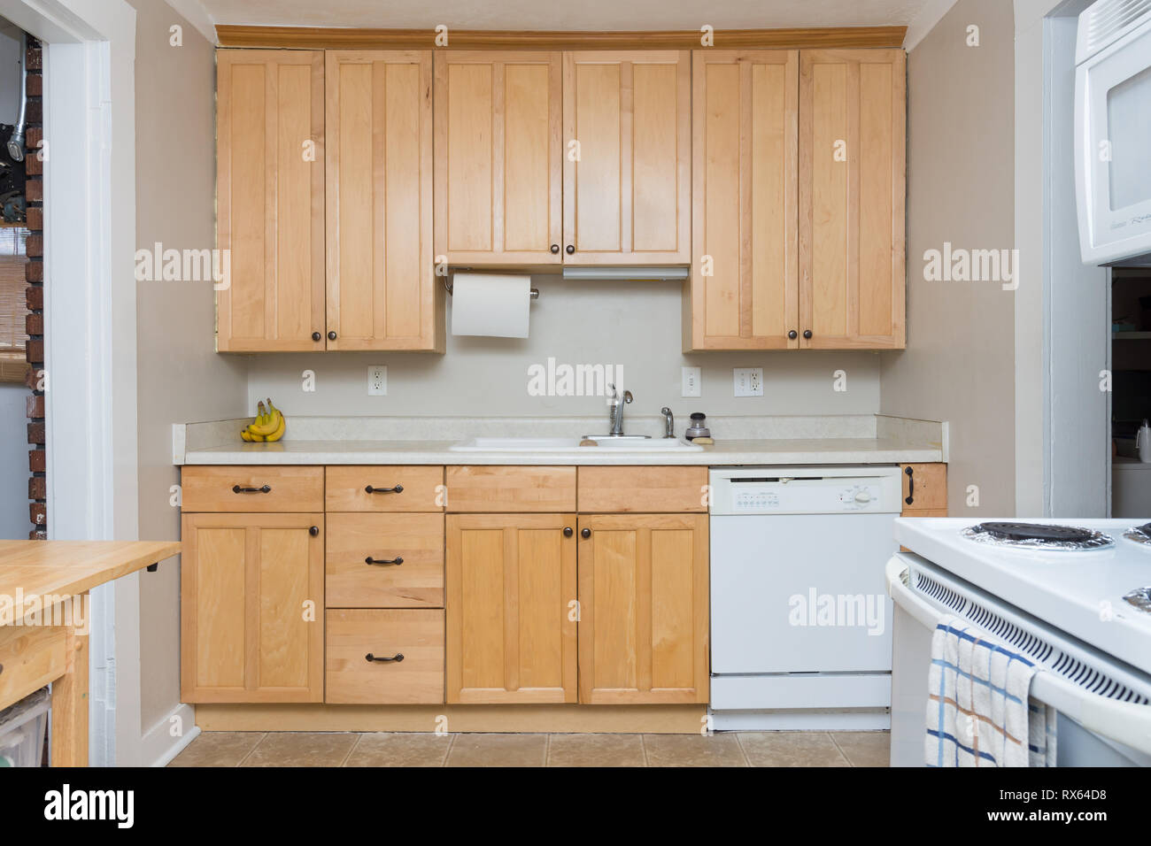 Clean light tan wood cabinets in small kitchen space Stock ...